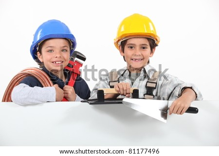 kids playing with craftsman tools