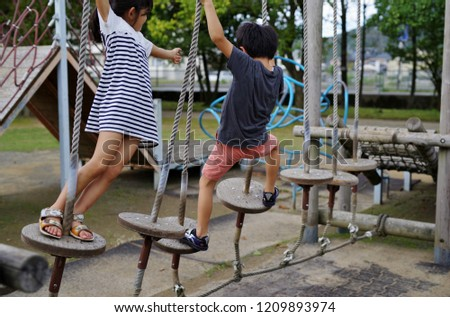 Kids playing with unstable playground equipment
