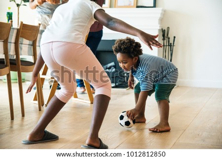 Kids playng ball indoors together