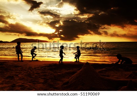 Kids plying on the beach