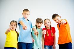 Kids pointing at camera