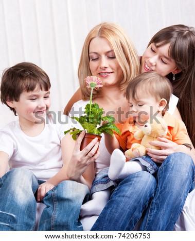 Kids presented mother a Gerber flower