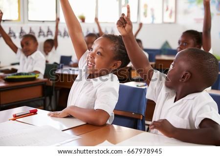 kids raising hands during...