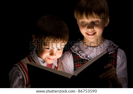 Kids reading the Book. Education