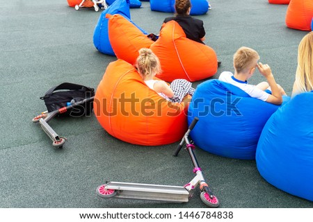 Kids relaxing on a bob bag in the relaxation space #1446784838