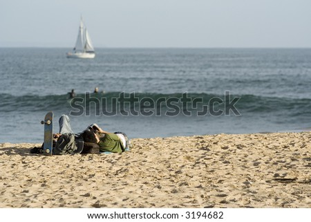kids relaxing on the beach