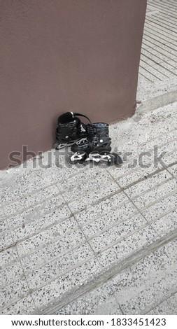 Kids' Roller blades left near an apartment Stok fotoğraf ©