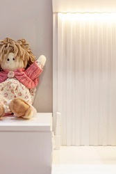 Kids room with decorated bookcase and rag dolls.