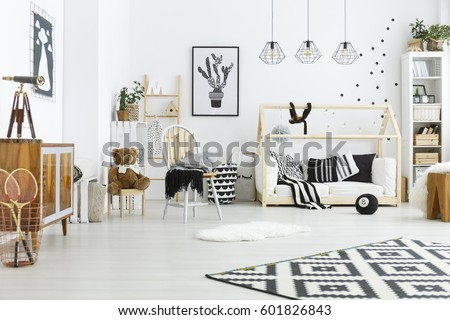Kids room with house bed, dresser, chair and bookshelf #601826843
