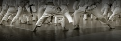 Kids's training on karate-do. Banner with space for text. For web pages or advertising printing. Photo without faces.