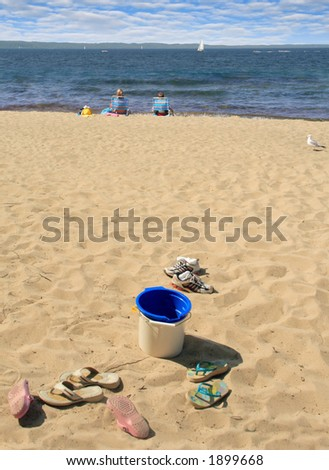 Kids shed their shoes and enjoy the beach