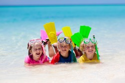 Kids snorkel. Beach fun. Children snorkeling in tropical sea on family summer vacation on exotic island. Child with mask and fins. Travel with kid. Little boy and girl learning to dive. Diving holiday