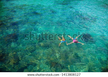 Kids snorkel. Beach fun. Children snorkeling in tropical sea on family summer vacation on exotic island. Child with mask and fins. Travel with young kid. Boy and girl learning to dive. Diving holiday. #1413808127