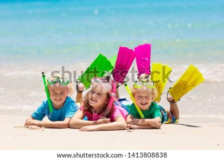 Kids snorkel. Beach fun. Children snorkeling in tropical sea on family summer vacation on exotic island. Child with mask and fins. Travel with young kid. Boy and girl learning to dive. Diving holiday. #1413808838