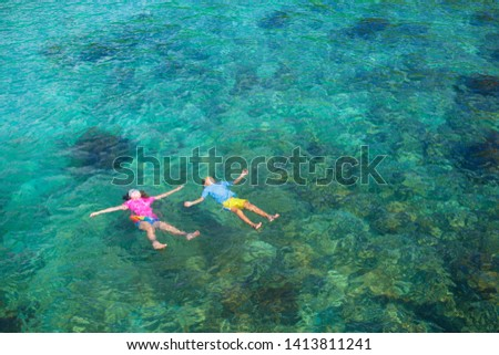Kids snorkel. Beach fun. Children snorkeling in tropical sea on family summer vacation on exotic island. Child with mask and fins. Travel with young kid. Boy and girl learning to dive. Diving holiday. #1413811241