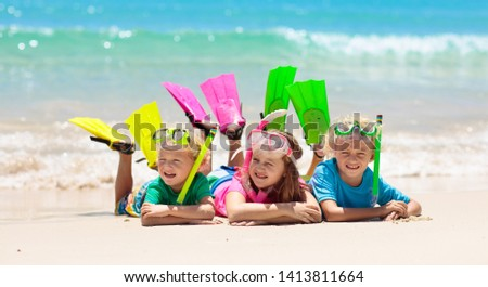 Kids snorkel. Beach fun. Children snorkeling in tropical sea on family summer vacation on exotic island. Child with mask and fins. Travel with young kid. Boy and girl learning to dive. Diving holiday. #1413811664