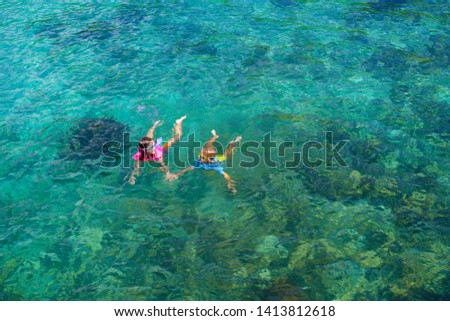 Kids snorkel. Beach fun. Children snorkeling in tropical sea on family summer vacation on exotic island. Child with mask and fins. Travel with young kid. Boy and girl learning to dive. Diving holiday. #1413812618