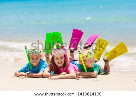 Kids snorkel. Beach fun. Children snorkeling in tropical sea on family summer vacation on exotic island. Child with mask and fins. Travel with young kid. Boy and girl learning to dive. Diving holiday. #1413814190