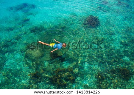 Kids snorkel. Beach fun. Children snorkeling in tropical sea on family summer vacation on exotic island. Child with mask and fins. Travel with young kid. Little boy learning to dive. Diving holiday. #1413814226