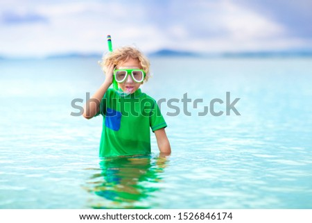 Kids snorkel. Beach fun. Children snorkeling in tropical sea on family summer vacation on exotic island. Child with mask and fins. Travel with young kid. Little boy learning to dive. Diving holiday. #1526846174