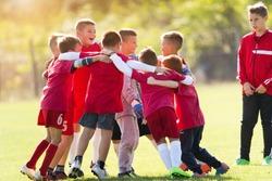 Kids soccer football team in huddle