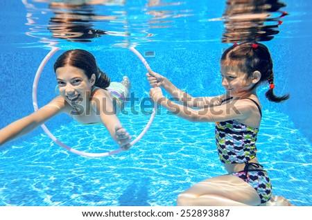 kids swim in pool underwater ...