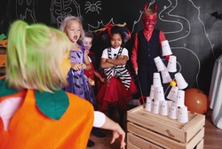 Kids taking part in halloween party