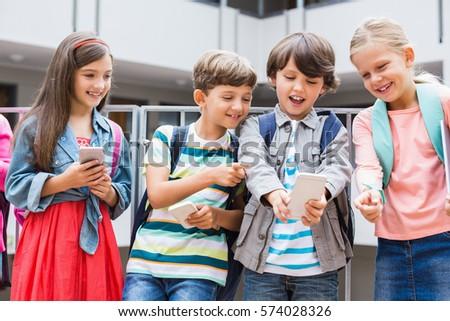 Kids taking selfie with mobile phone on school terrace
