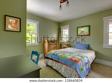 Kids teenager  bedroom with desk and green walls.