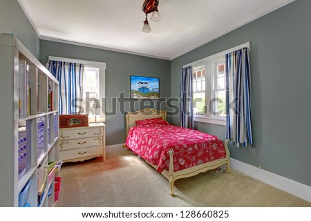 Kids teenager  with red bed and grey walls.