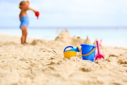 kids toys and little girl building sandcastle