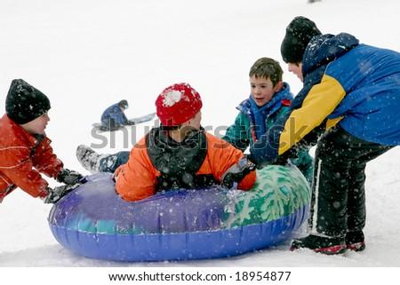 Kids Tubing - stock photo