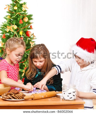 Kids using molds to make Christmas homemade cookies