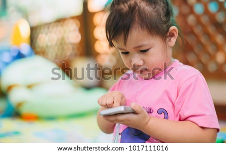 Kids using smart phone : Some research says entertainment media (including TV) be avoided for infants and children under age 2 and cell phone radiation can harm your baby and may cause of ADHD.  #1017111016