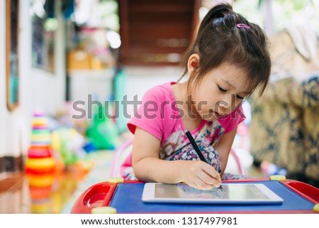 Kids using tablet for drawing : Some research says entertainment media (including TV) be avoided for infants and children under age 2 and cell phone radiation can harm your baby and may cause of ADHD.