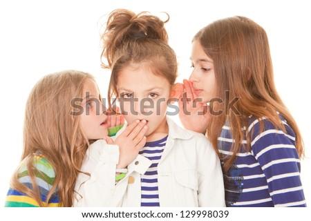 kids whispering bad news gossip scandal to shocked child