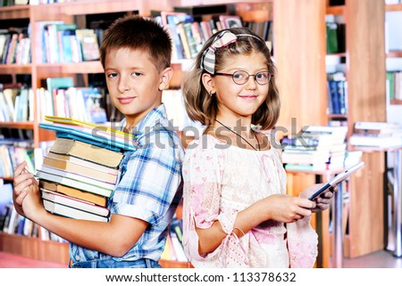 Kids with books and e-reader