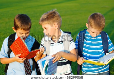 Kids with books  in park