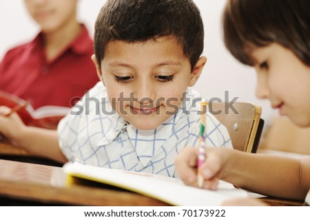 Kids working schoolwork in the school, classroom, togetherness