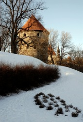 Kiek in de Kok is a tower that forms part of the fortifications of Tallinn in Estonia. It is an old artillery tower that forms part of the city wall surrounding Tallinn old town. In winter with snow.