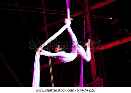 """KIEL, GERMANY - JULY 18: Polish acrobat group """"Ocelot"""" in the  rigging of sailing ship """"Fryderyk Chopin"""" on the occasion of """"Chopin / Polska / The Course"""" Tour in Kiel, July 18, 2010 in Kiel, Germany"""
