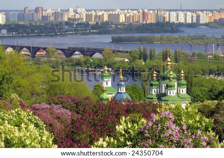 Kiev Botanic Garden in spring. View to the Vydubichi monastery and left bank of Dnipro river