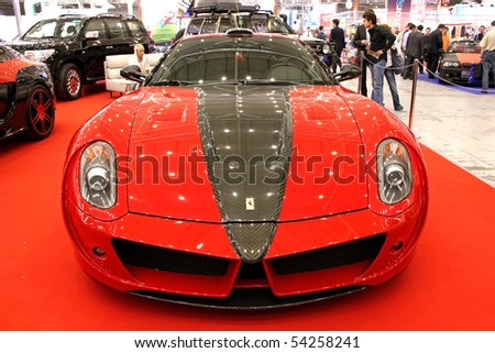 """KIEV - MAY 27: A Red Ferrari on display at Annual automotive-show """"SIA 2010"""" May 27, 2010 in Kiev, Ukraine. - stock photo"""
