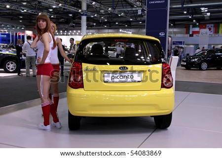 "KIEV - MAY 27: Annual automotive-show ""SIA 2010"". May 27, 2010 in Kiev, Ukraine. Yellow KIA Picanto"