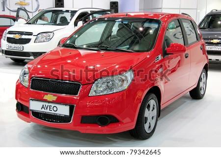 "KIEV - MAY 26: Chevrolet Aveo at yearly automotive-show ""SIA 2011"". May 26, 2011 in Kiev, Ukraine."