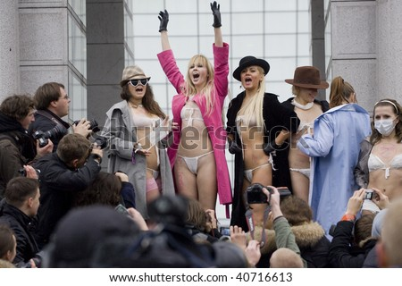 KIEV - NOVEMBER 9: Anti-stress action by Ukrainian womens movement FEMEN. Activists wearing underwear made from protective masks during a protest. November 9, 2009 in Kiev, Ukraine.