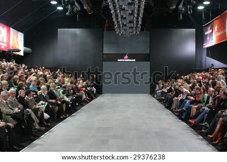 KIEV - OCTOBER 16: Guests wait for fashion models parade at men's designer Nataliya Soboleva fashion show during Ukrainian Fashion week October 16, 2006 in Kiev, Ukraine.
