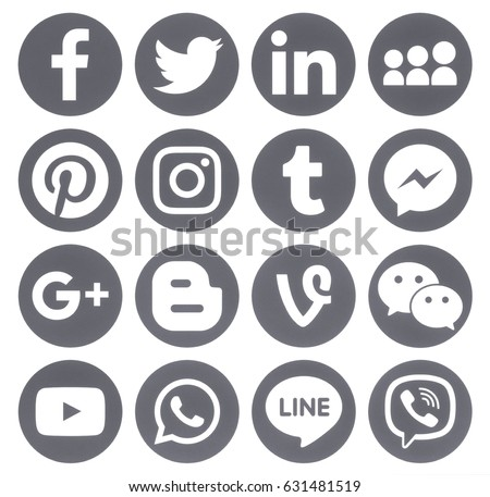Kiev, Ukraine - April 27, 2017: Collection of popular grey round social media icons, printed on paper: Facebook, Twitter, Google Plus, Instagram, Pinterest, LinkedIn, Blogger, Tumblr and others.