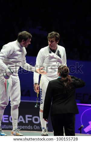 KIEV, UKRAINE - APRIL 14, 2012: Hungarian Peter Somfai and Italian Enrico Garozzo during the match for 3rd place in men's epee during World Fencing Championship on April 14, 2012 in Kiev, Ukraine