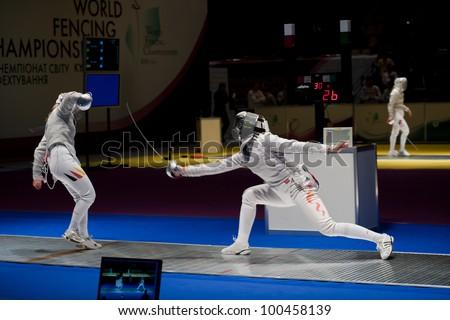 KIEV, UKRAINE - APRIL 13: Team tournament final match of the 2012 Women world fencing on April 13, 2012 in Kiev, Ukraine.